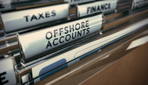 Folder tabs with focus on offshore account tab. Business concept image for illustration of tax evasion.